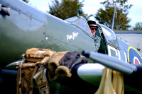 VISITORS IN THE COCKPIT OF A SPITFIRE AIRCRAFT AT GOODWOOD REVIVAL AT GOODWOOD MOTOR CIRCUIT, CHICHESTER,  ON 11/09/2015