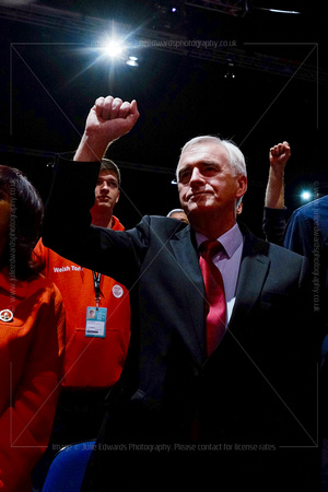 John McDonnell, Shadow Chancellor of the Exchequer, raises his fist during the singing of The Red Flag anthem at the end of the  conference.