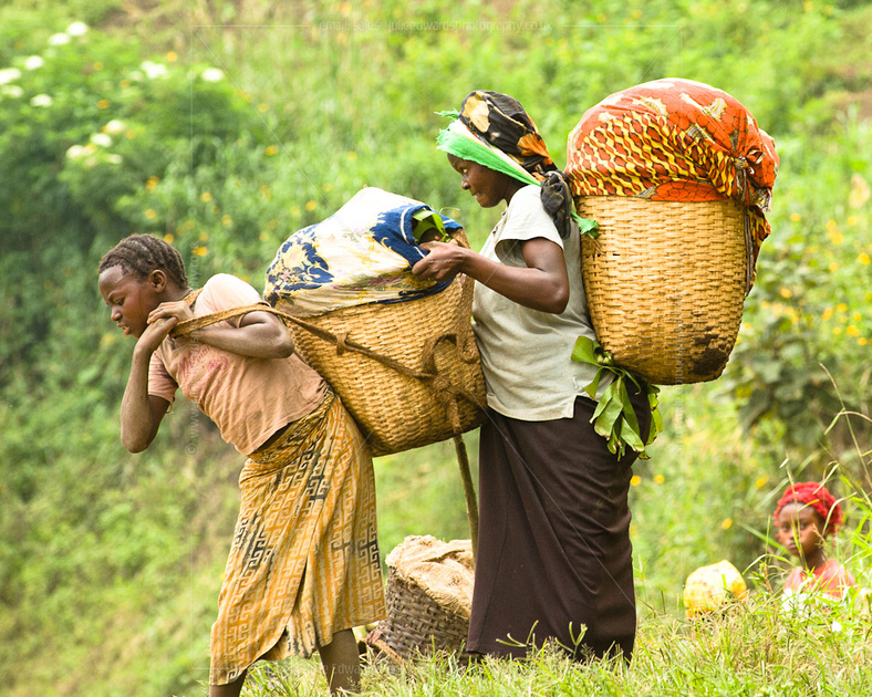 Women load up and carry heavy goods on their backs.