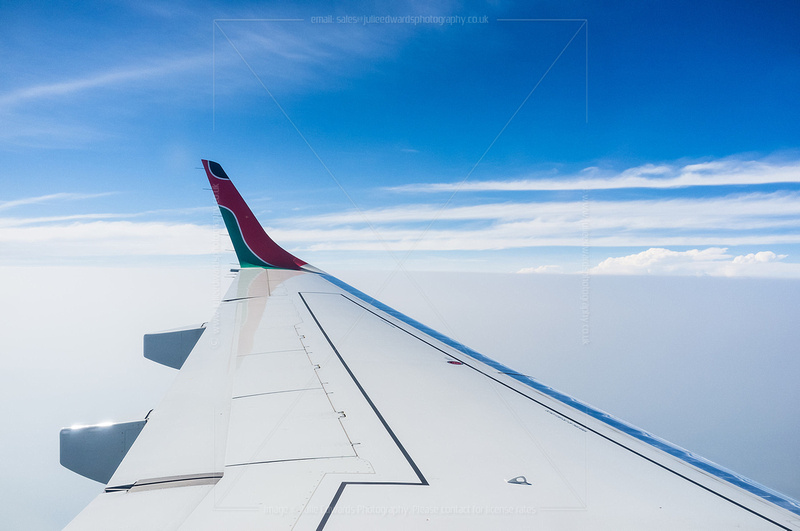 The wing of a Kenya Airways 777 in flight.
