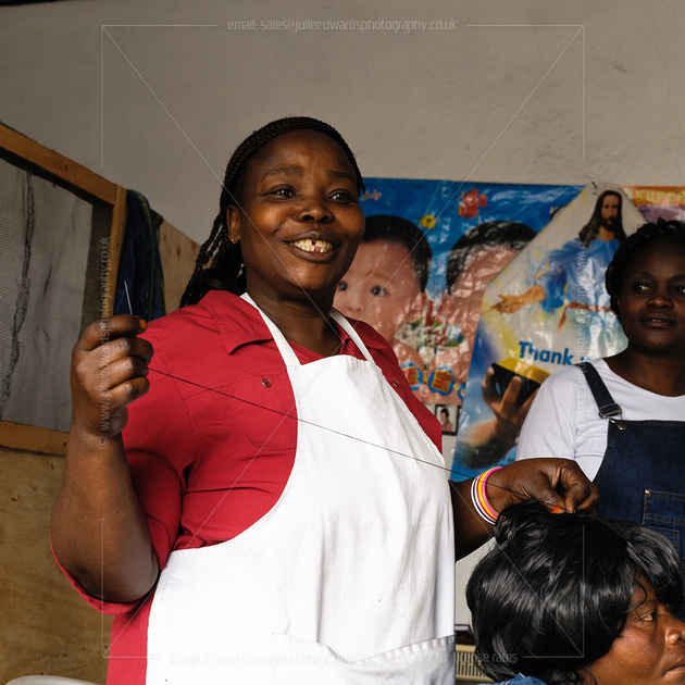 Florence: the first and only female barber in Goma.