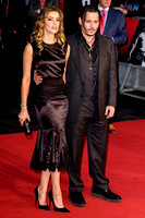 Johnny Depp with Amber Heard arrives on the red carpet for the London Film Festival screening of Black Mass