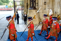 The Guard arrive depart after the monarch as Black Rod , Lt Gen David Leakey CMG CBE , looks on