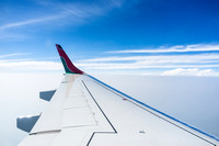 The wing of  a Kenya Airways 777 in flight. Picture by Julie Edw