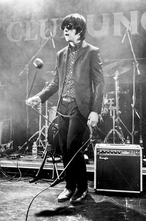 The Strypes Lead Singer Swinging a microphone monochrome photograph