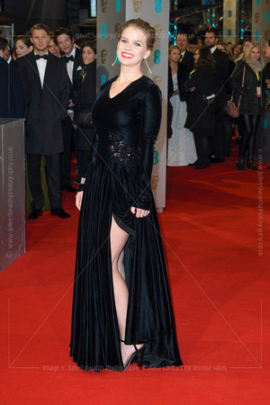 ALICE EVE ATTENDS EE BRITISH ACADEMY FILM AWARDS ARIVALS AT ROYAL OPERA HOUSE, LONDON, UK ON 08/02/2015
