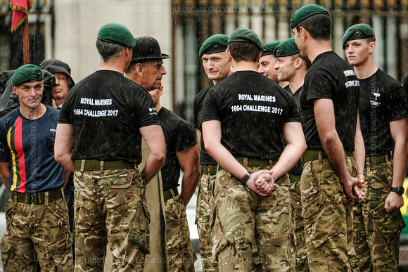 The Duke of Edinburgh meets the Royal Marines 1664 Global Challenge team who ran the16.64 miles each day for 100 days, totalling a distance of 1664 miles.